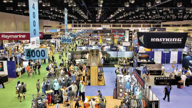 Tackle distributors, dealers, retailers and outdoors media representatives mingle on a busy ICAST show floor.