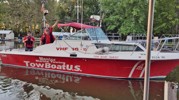 The crew of TowBoatUS Mentor: deckhand George Vojush Jr. (left); the new owner, Capt. Jake Hardy; and deckhand Justin Hardy.