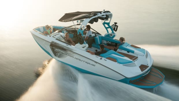Photo of Nautique boat and two riders