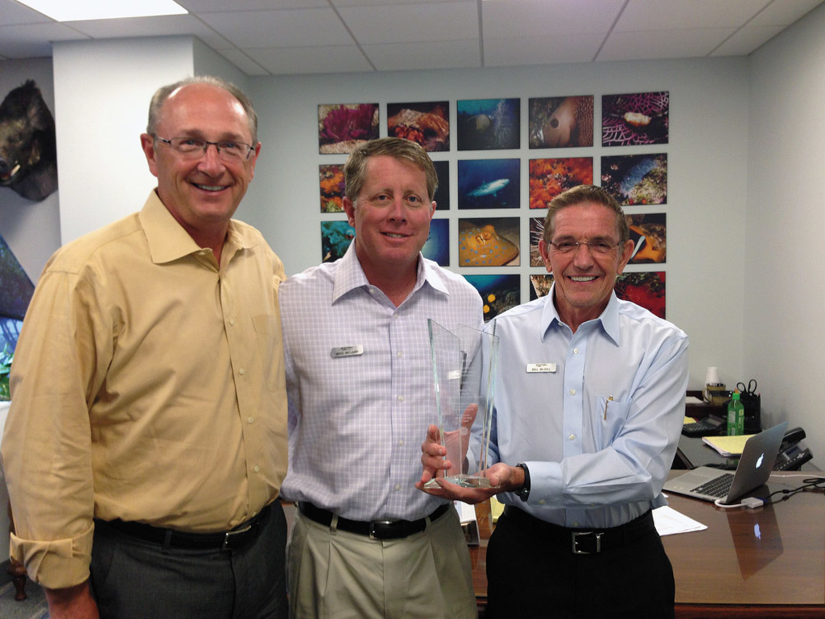 Van Wagoner with MarineMax executive vice president and CFO Mike McLamb (center)  and chairman/CEO Bill McGill.