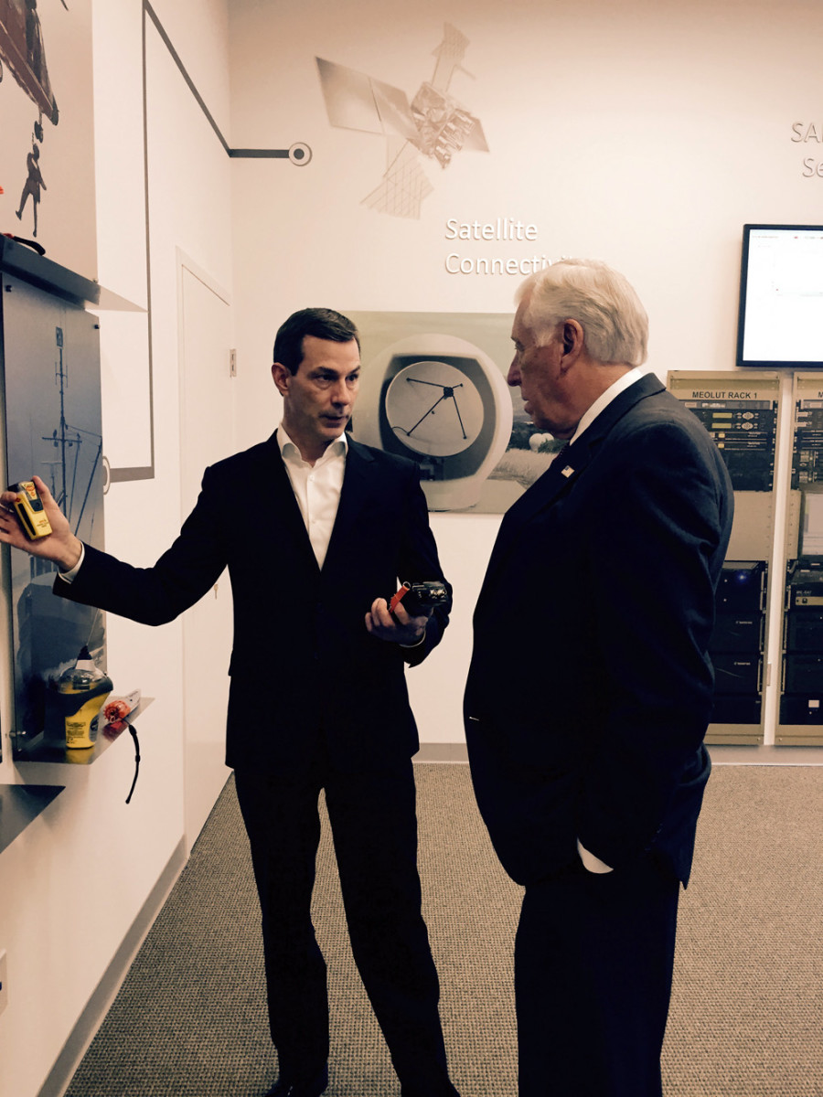 McMurdo search-and-rescue business manager Jacob Blankenship (left) briefs U.S. Rep. Steny Hoyer, D-Md., on McMurdo's Mission Control and Rescue Coordination Center software and solutions during a recent visit to McMurdo's Americas headquar-ters in Maryland.
