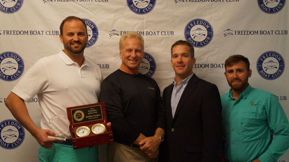 Franchise of the Year winner Bobby Parker and his team are shown with Freedom Boat Club President and CEO John Giglio (second from right).