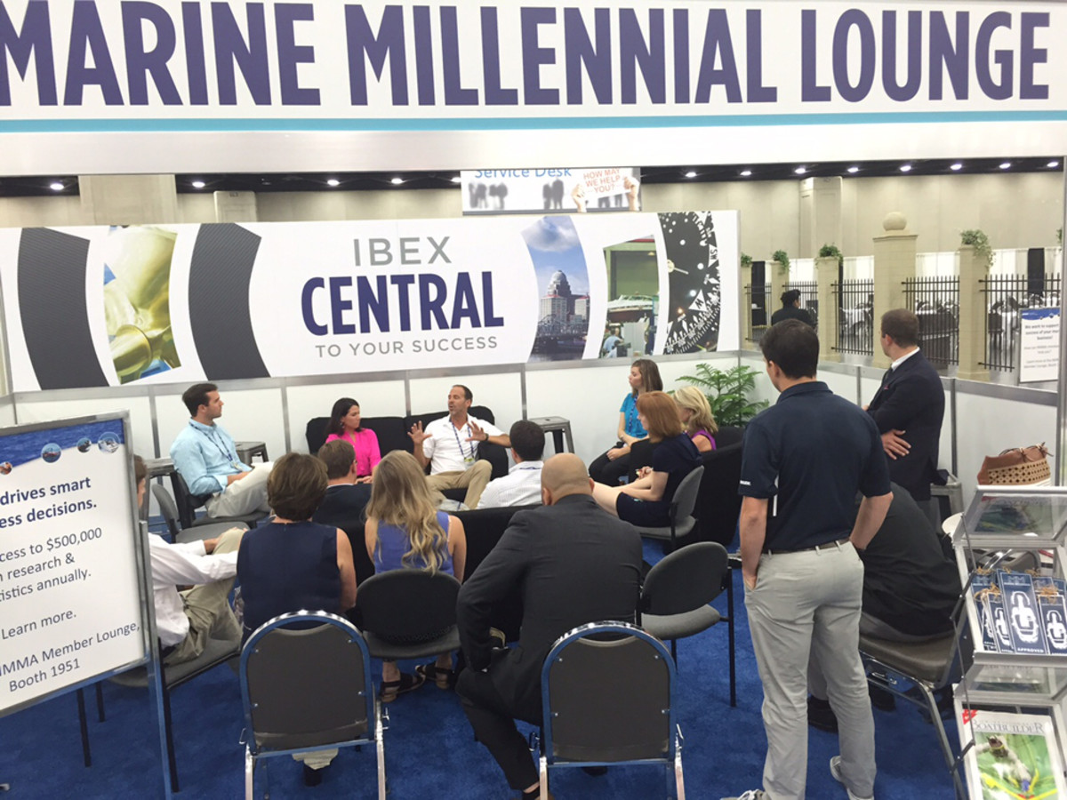 Members of IBEX's new Marine Millennial group gather at the Millennial Lounge Tuesday to hear Marquis-Larson Group president and CEO Rob Parmentier.