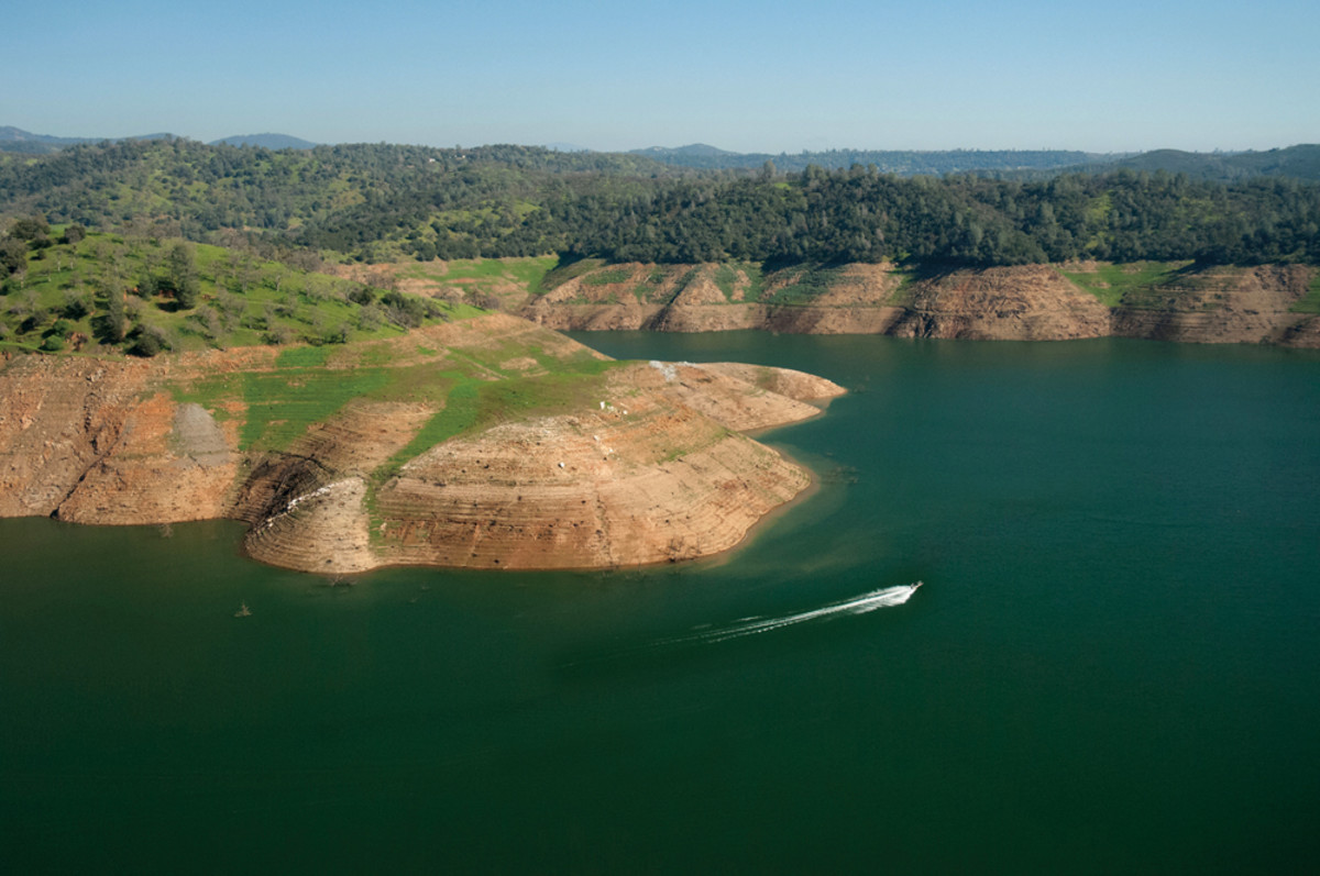 Aerial view showing extreme low water (drought) conditions at New Melones Lake on February 20, 2015.