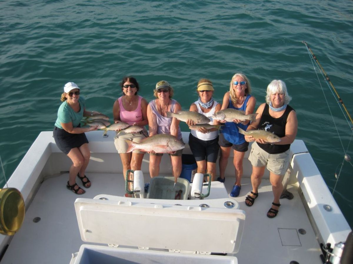 "Six Florida women who participated in a ""Ladies, Let's Go Fishing!"" event are shown with their catch out of Islamorada on Jan. 9: Ana Rodriguez Cepero, (left) Miami; Collette Dennehy, Fort Lauderdale; Margie Plaxton, Punta Gorda; Amy Carrasquillo, Pompano Beach; ""Ladies, Let's Go Fishing!"" founder Betty Bauman, Davie; and Mary Metcalf, Punta Gorda."