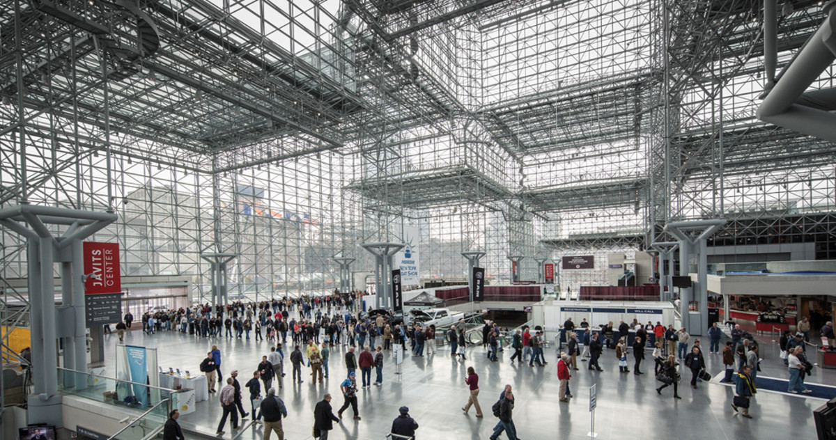 Opening day saw a long line waiting to enter the Javits Center (top). Once inside, many headed for the Sea Ray exhibit.