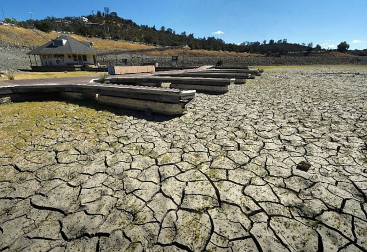 Docks are shown sitting on parched ground at California's Folsom Lake. El Niño season rains have been responsible for a dramatic rise in the lake's water level during the past month.