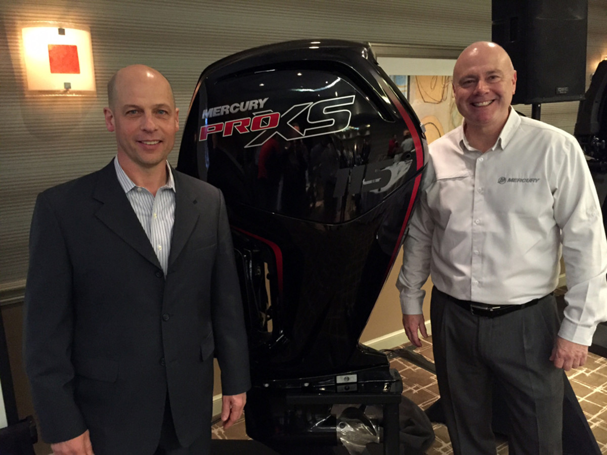 Mercury Marine president John Pfeifer (left) and Brunswick chief technology officer David Foulkes presented several new engines in Miami Wednesday night, including this 115-hp Pro XS FourStroke.