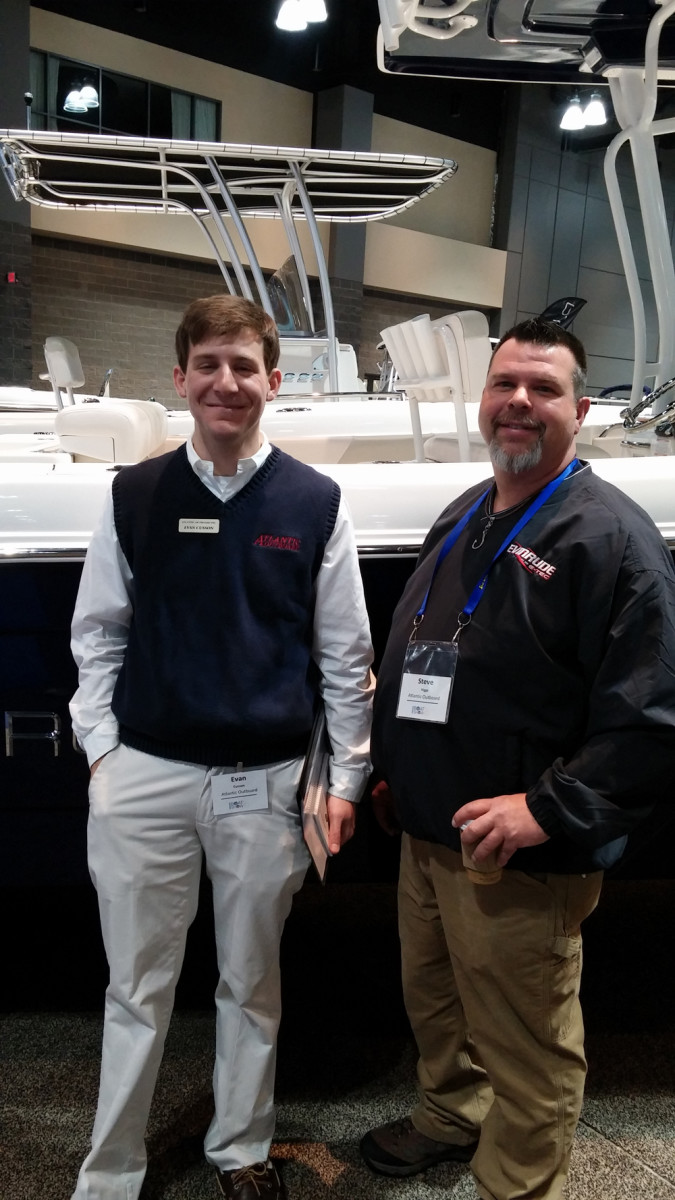 Evan Cusson, sales manager at Atlantic Outboard, is shown with Steve Higgs, who works in parts, electronics and engine sales at the Westbrook, Conn. dealership.