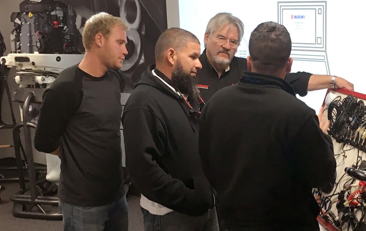 Jon Ponedel (third from left) of Suzuki instructs technicians on SDS diagnostic soft-ware.