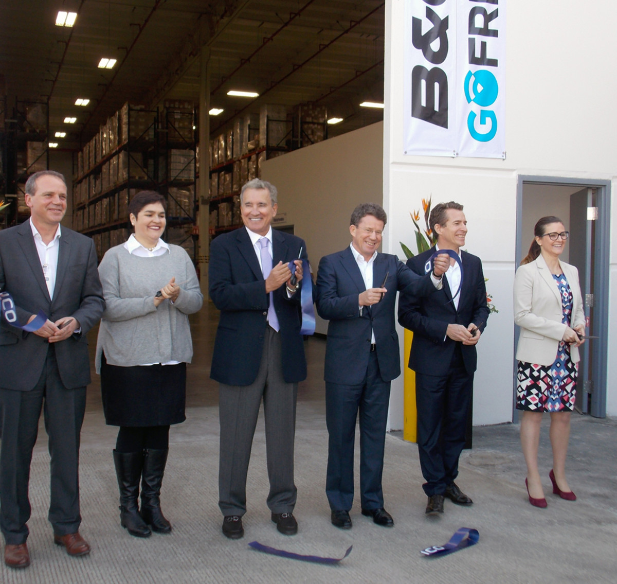 Jim Brailey (left) of Navico; Juanita Floriano, Baja California secretary of labor; Carlo Bonfante, Baja California secretary of economic development; Leif Ottosson, president and CEO of Navico; and Hugo Maurstad and Anita Hatherley of Navico are shown at the ribbon-cutting for the company's expanded manufacturing facility in Ensenada, Mexico.