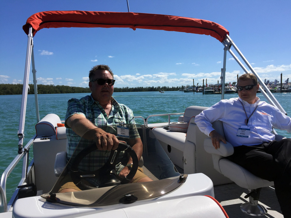 Mark Dupuie (left), president of Qwest Pontoon Boats and Apex Marine, and Torqeedo president Steve Trkla gave sea trials at the Miami International Boat Show to demonstrate how quiet and capable Torqeedo's engine is.