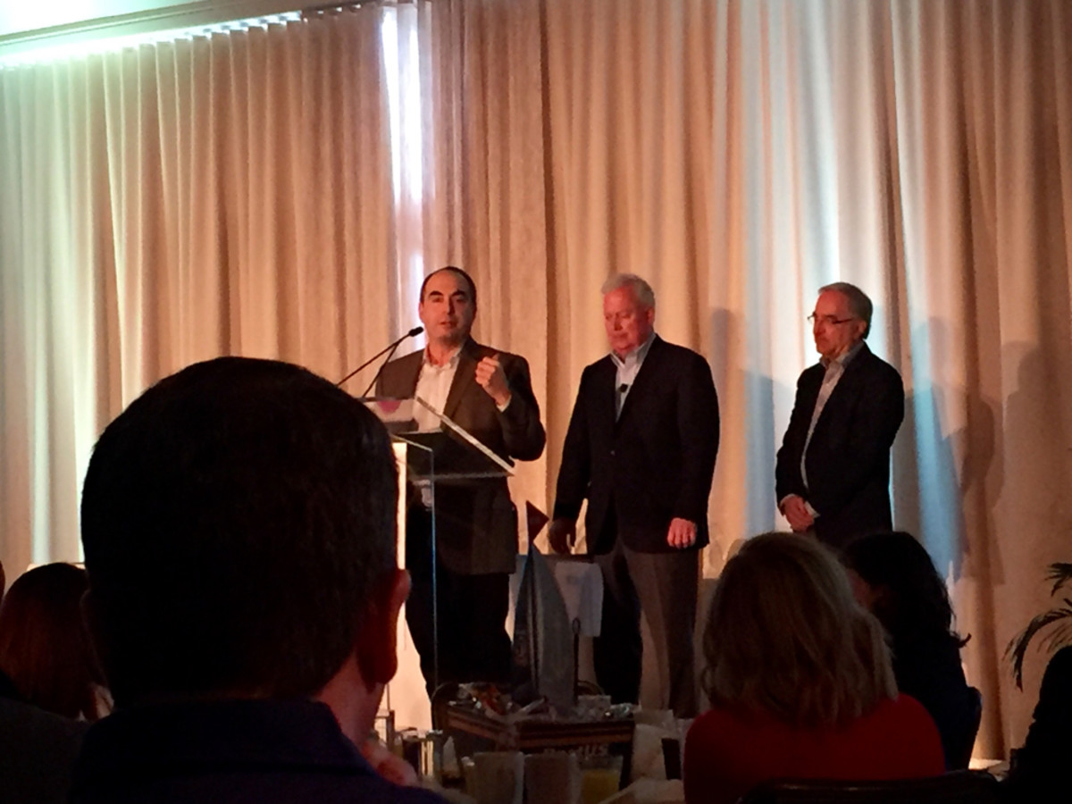 Rick Garelick, senior vice president of Garelick Manufacturing Co., speaks after he and his cousin, Ken, (right) received the 2016 Alan J. Freedman Memorial Leadership Award today at the industry breakfast during the Miami International Boat Show. Na-tional Marine Manufacturers Association president Thom Dammrich is at center.