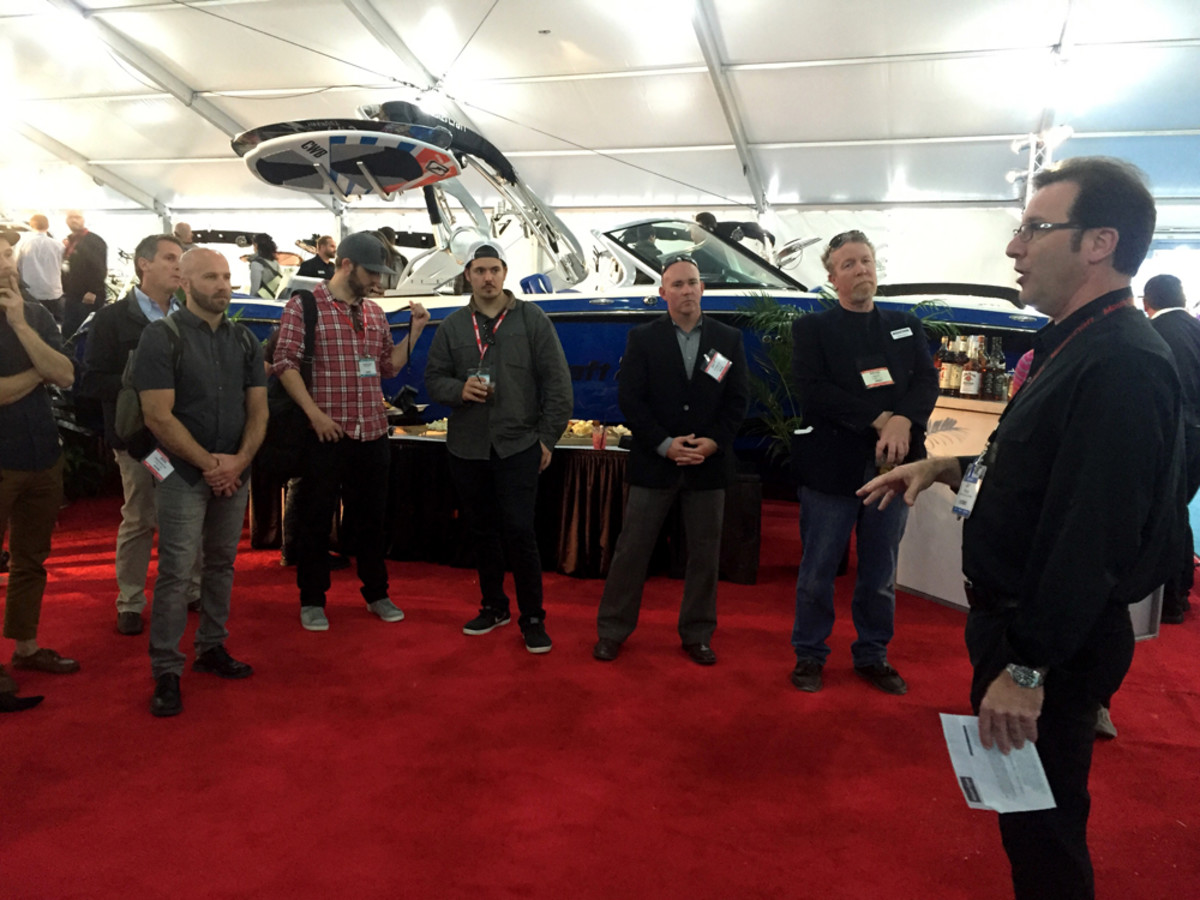 MasterCraft vice president of global sales and marketing Jay Povlin (right) meets with the marine press at the Miami show.
