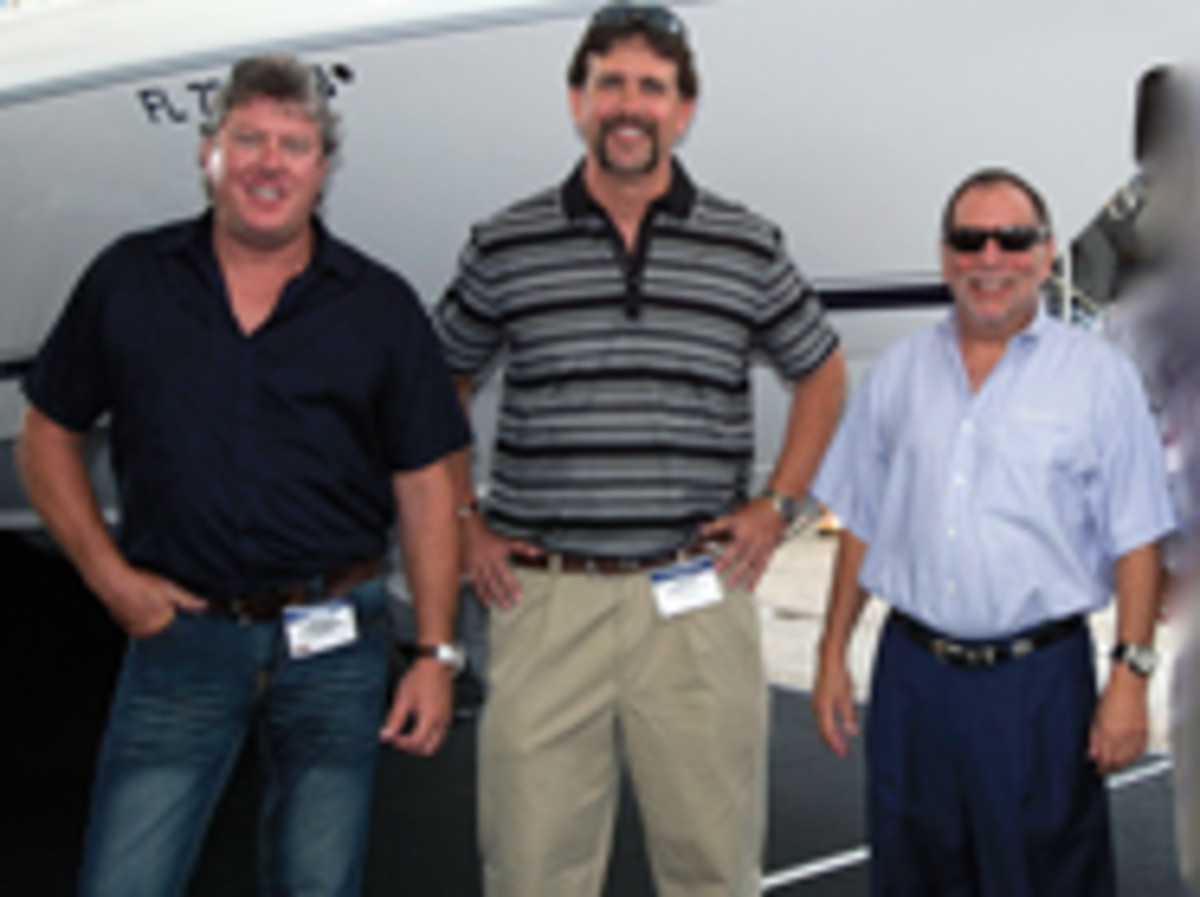 From left, COO Mark Beaver, Clinton and vice president of sales Mike Obolsky have been together at Intrepid for 23 years,
