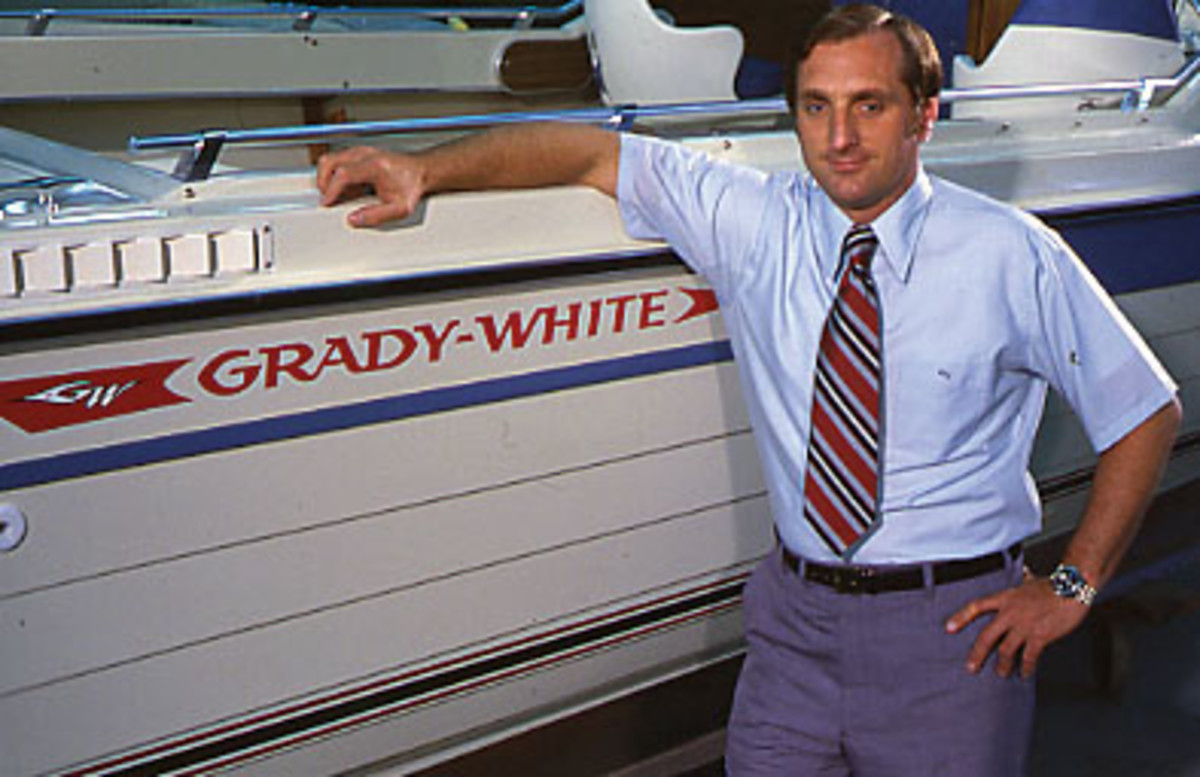 Eddie with an early Grady-White model at a mid-1970s boat show.