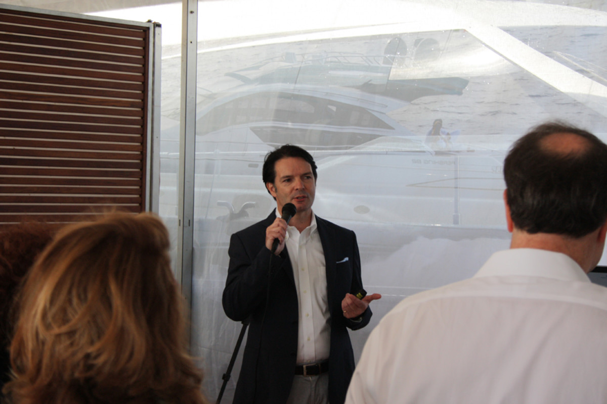 Ferretti Group Americas President and CEO James Henderson addresses a press gathering Thursday morning at the group's display along Collins Avenue.