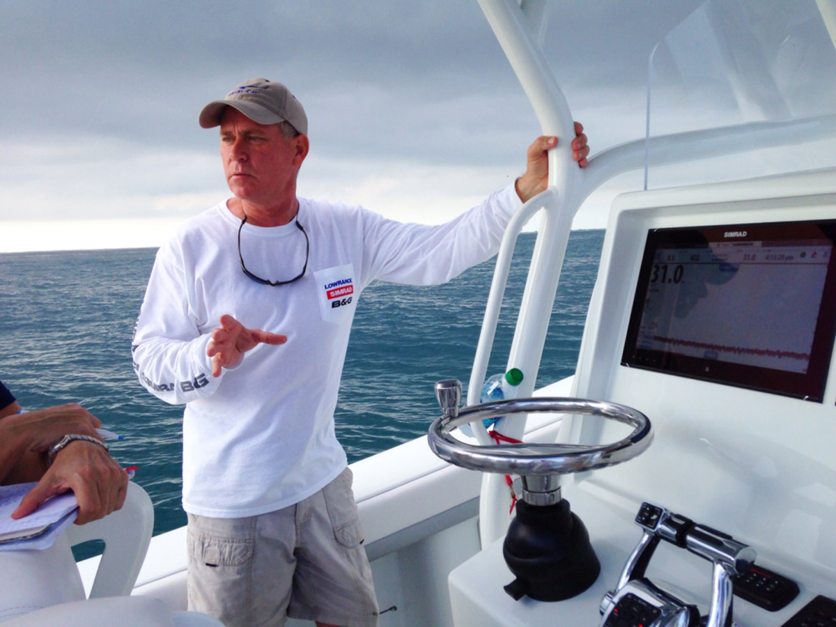 Simrad representative Mark Maus explains some of the high-tech features found on the twin 16-inch Simrad multitouch displays on his center console.