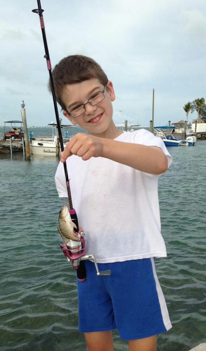 "Aiden Austin won the ""Smallest Fish"" Guy Harvey scholarship award for his photo of a snapper."