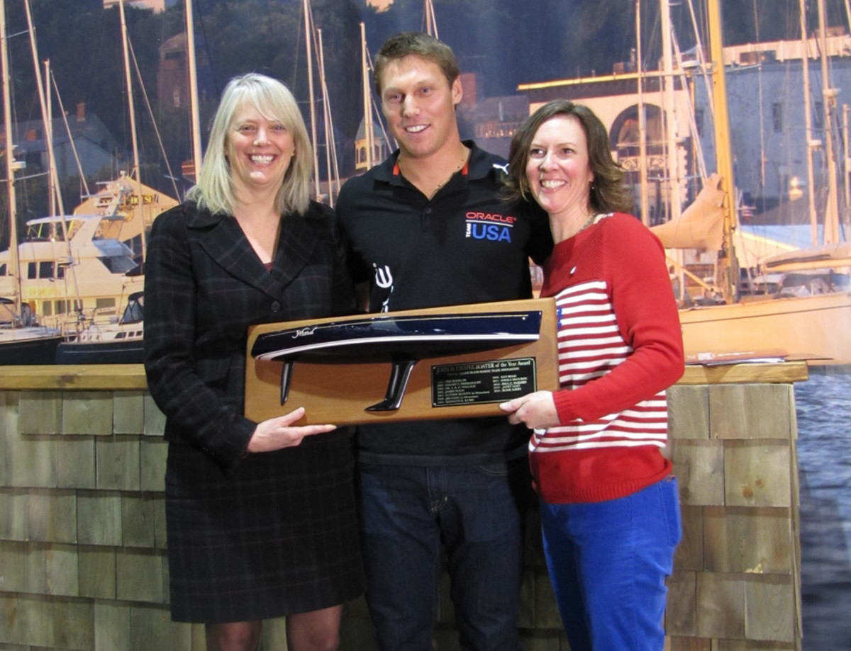 Rome Kirby, of America's Cup champion Oracle Team USA, received the 2014 John H. Chafee Boater of the Year Award at the show. At left is  Rhode Island Department of Environmental Management director Janet Coit, and at right is Rhode Island Marine Trades Association president Wendy Mackie.