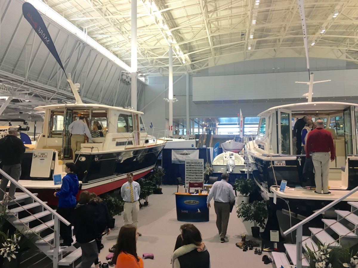 There were sold signs on several of the larger boats at the New England Boat Show, such as this Sabre Yachts 42SE (left) and Back Cove Yachts 37 (right), which were displayed by Boston Yacht Sales. The show ended Sunday.