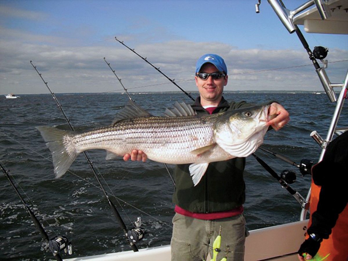Anglers want big fish, Leonard says, proudly showing off a trophy striped bass.