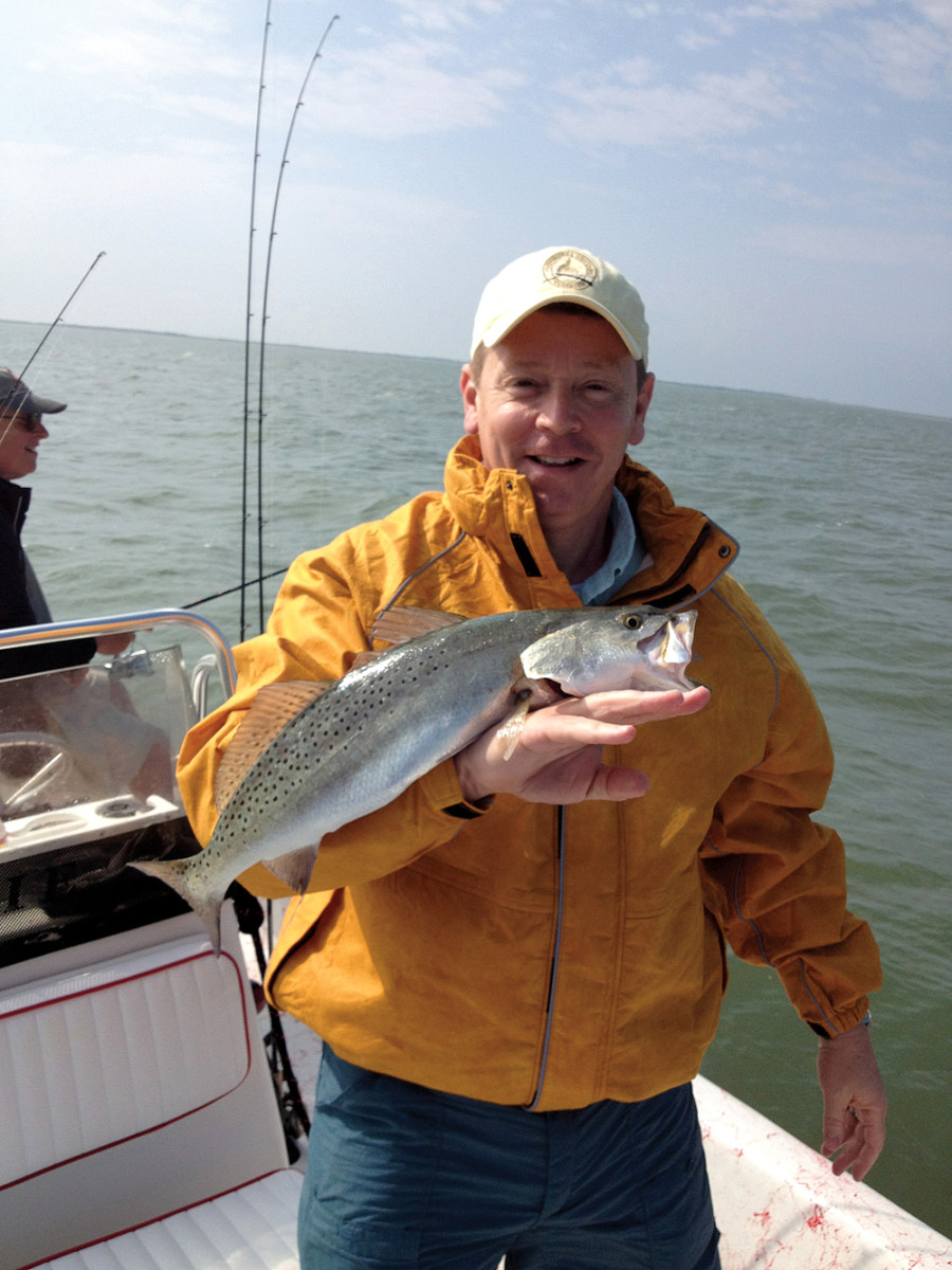 Angers with a speckled trout.