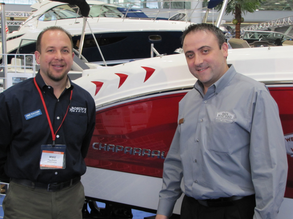 Mike Fulcher (left), a yacht service foreman at Bosun's Marine, and Michael Bodnar, general manager of Fay's Boat Yard on Lake Winnipesaukee, N.H., have been pleased with the show. It continues through Sunday.