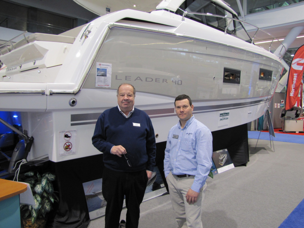Lou (left) and Tim Bassett, of Louis Marine, are shown with the Jeanneau Leader 40 Sport Coupe at the New England Boat Show at the Boston Convention & Exhibition Center.