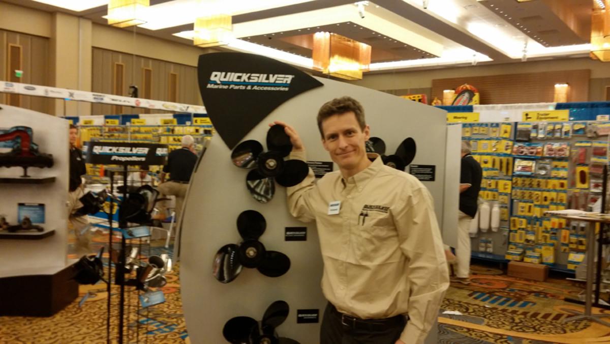 Dirk Bjornstad of Mercury Marine is shown with a display of Quicksilver propellers.