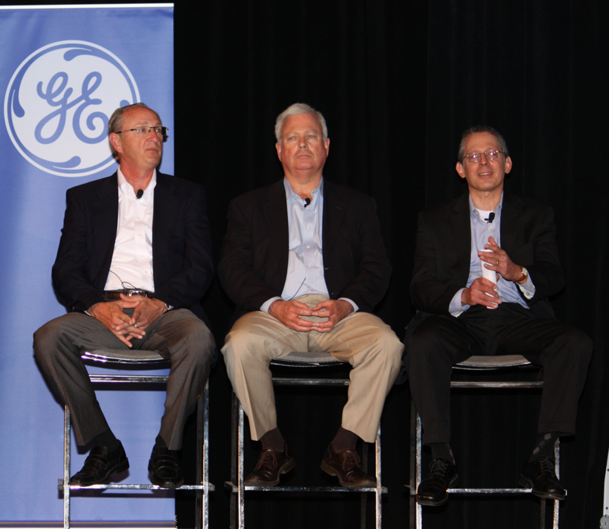 From left are GE Capital Commercial Distribution Finance Marine Group president Bruce Van Wagoner; NMMA president Thom Dammrich; and Rob Podorefsky, managing director of the GE Capital Interest Rate Management Group.