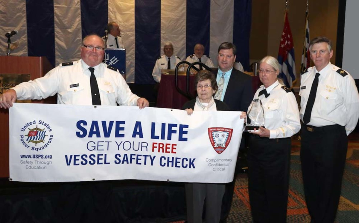 """R/C James L. Pahl-Washa, JN (left); P/D/Lt/C Carole G. Tulip, JN; Ted Sensenbrenner, assistant director for boating safety at the BoatUS Foundation; D/C K.J. """"Fuzzy"""" Jones, AP; and C/C Robert A. Baldridge, SN, are shown at the U.S. Power Squadrons' annual meeting."""