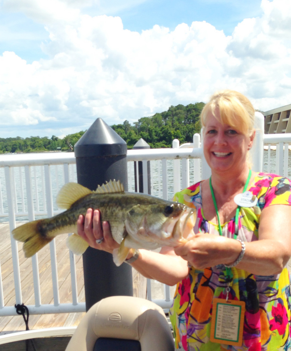 Disney alliance management marketing manager Stacia Wake is shown with a freshly caught bass.