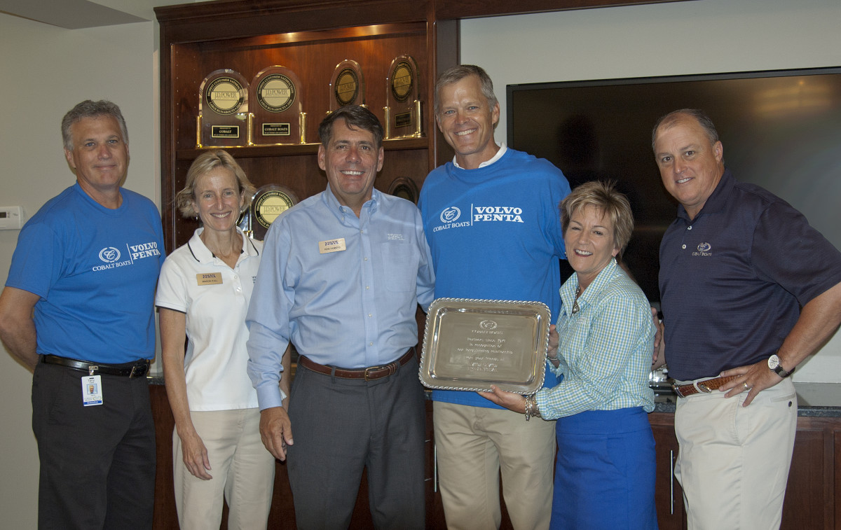 Cobalt Boats president Terry Clark, (left); Marcia Kull and Ron Huibers, vice president and CEO at Volvo Penta of the Americas; Cobalt CEO Paxson St. Clair; Susan Bonivich, OEM sales manager at Volvo Penta North America; and Gavan Hunt, vice president of sales and marketing at Cobalt, are shown at Cobalt's headquarters in Kansas.