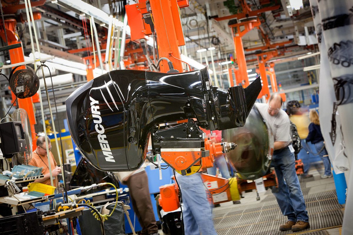 """One of Mercury's new 4-strokes hangs from a """"J-hook"""" during assembly at the plant in Fond du Lac, Wisc."""