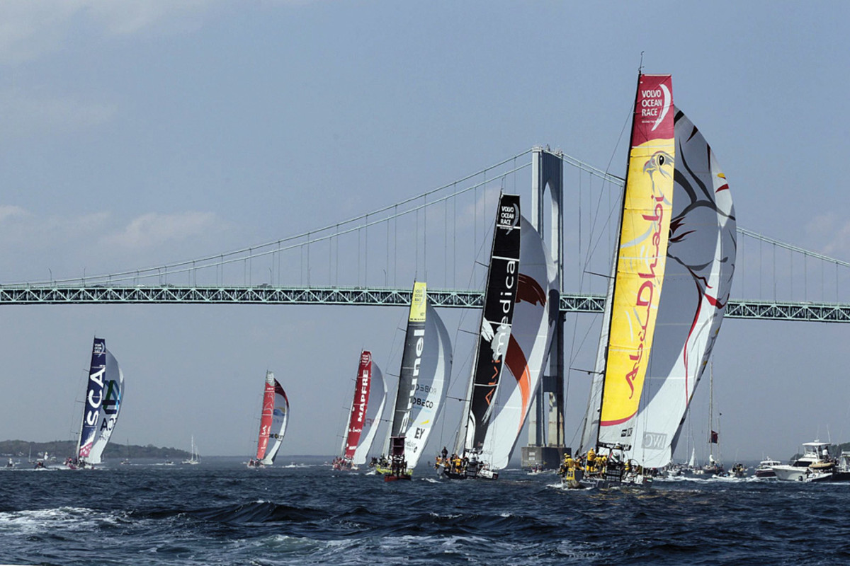 The Volvo Ocean Race boats pass under the Newport Bridge at the start of Leg 7, bound for Lisbon, Portugal.