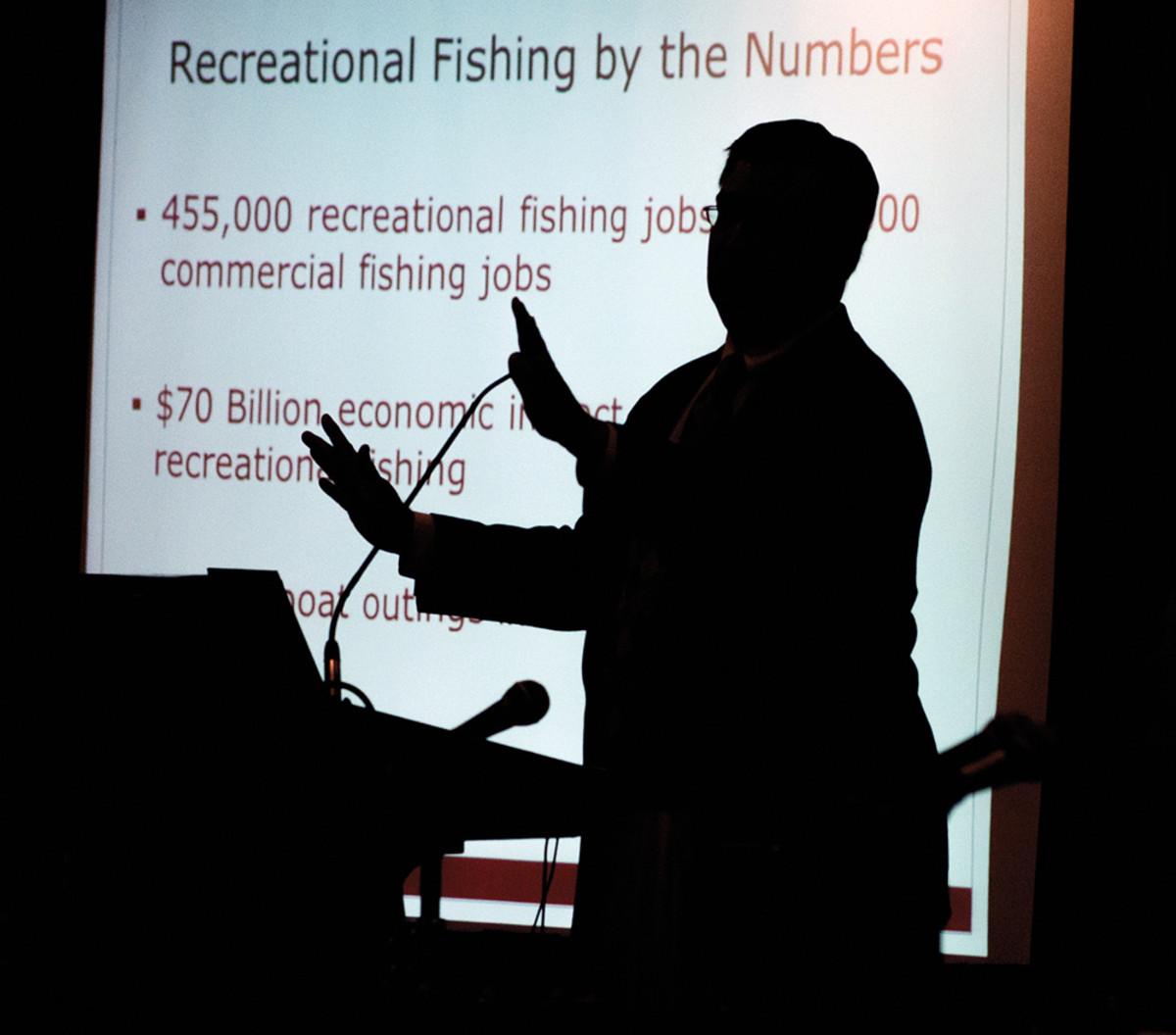 NMMA lobbyist Jeff Daniels illustrates the economic impact of recreational fishing,