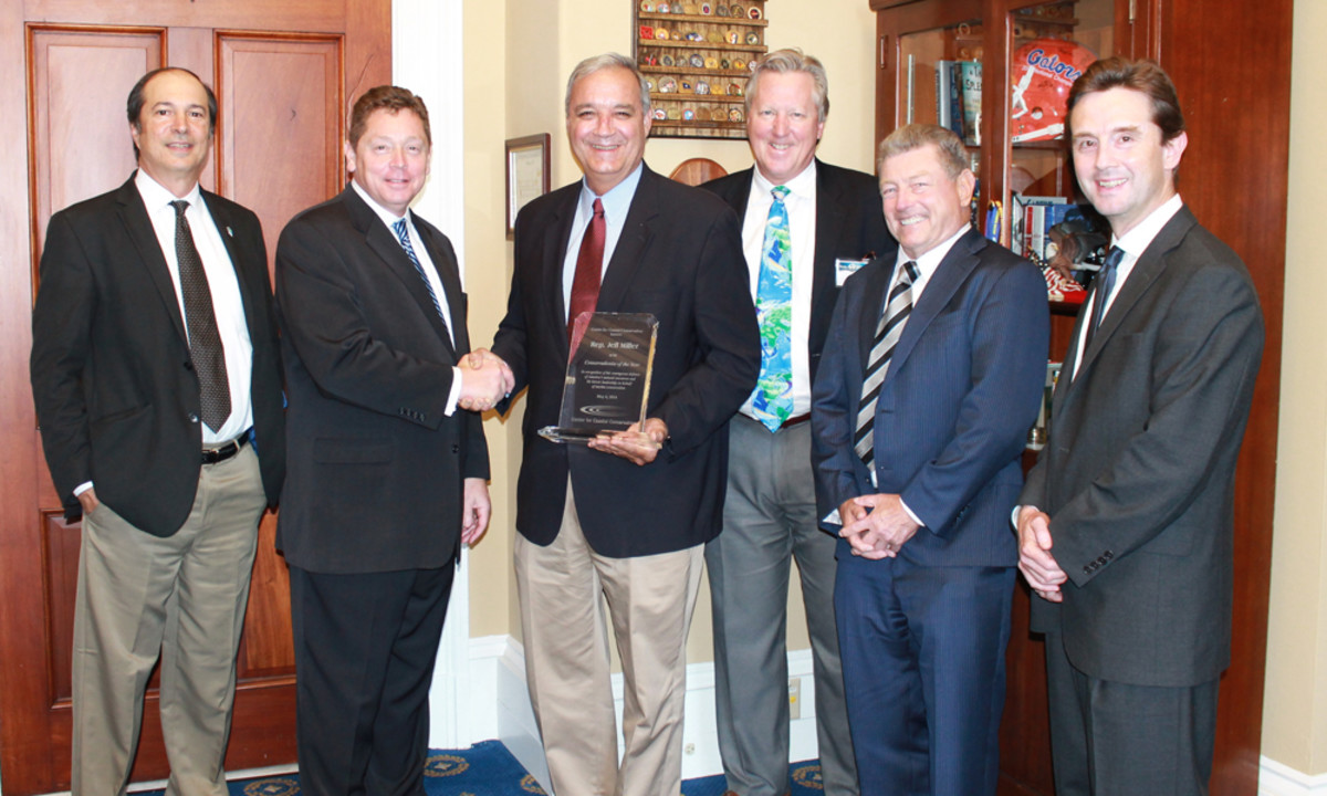 U.S. Rep. Jeff Miller, R-Fla., (center, holding award) received the Conservationist of the Year Award from the Center for Coastal Conservation on Tuesday. Others are, from left, Guy Harvey Ocean Foundation executive director Tony Fins; Center for Coastal Conservation president Jeff Angers; Guy Harvey Ocean Foundation president Steve Stock; Artmarine's Tim Choate; and Boston Whaler president Huw Bower.