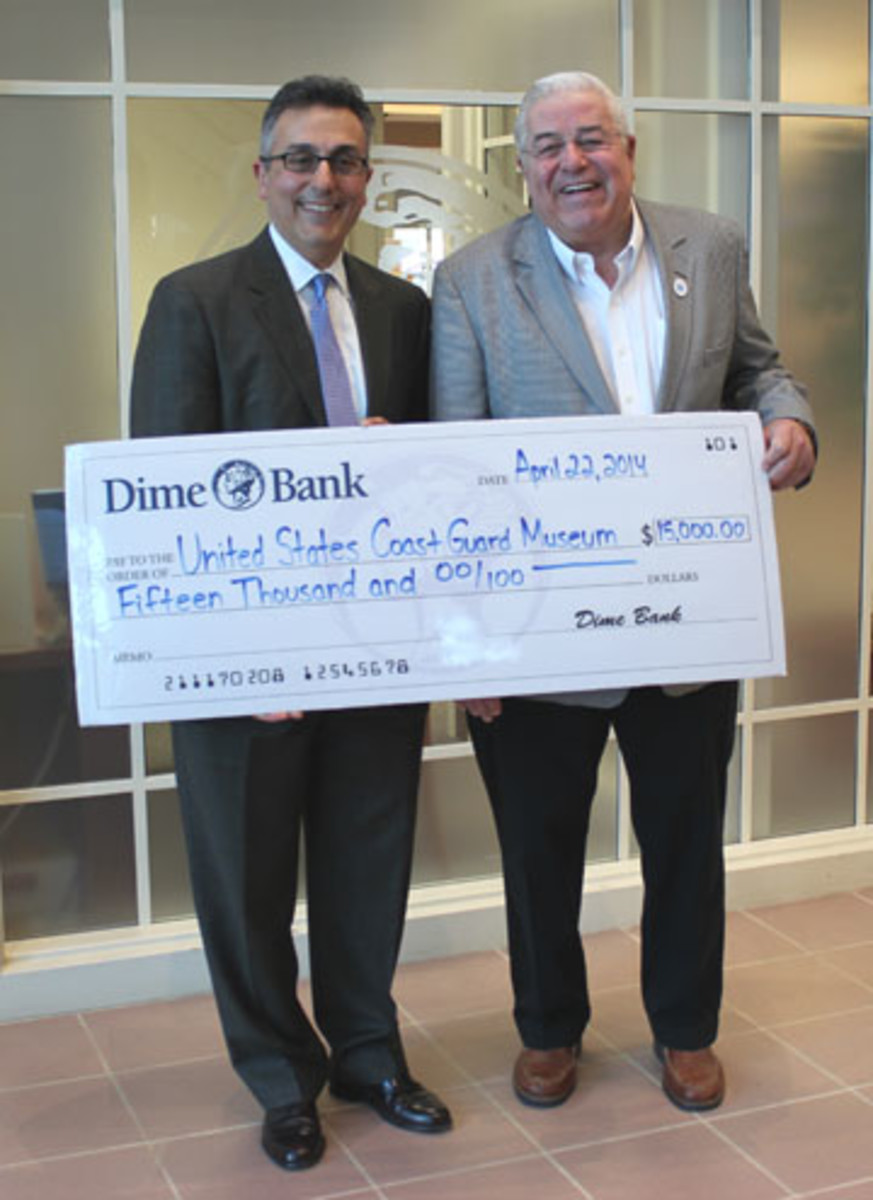 Dime Bank president and CEO Nick Caplanson (left) is shown with National Coast Guard Museum Association treasurer John S. Johnson.