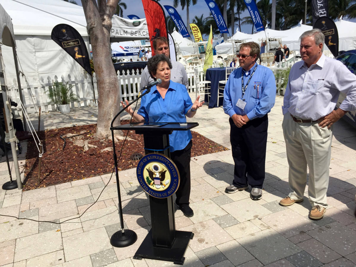 """U.S. Rep. Lois Frankel (D- Fla.) promoted legislation Friday at the Palm Beach Interna-tional Boat Show that would allow sellers of foreign-flagged boats to defer payment of the import duty until after the sale takes place. Fort Lauderdale Mayor Jack Seiler, (rear at left); Jeff Erdmann, of the Florida Yacht Brokers Association; and Efrem """"Skip"""" Zim-balist III, CEO of Show Management, also attended."""
