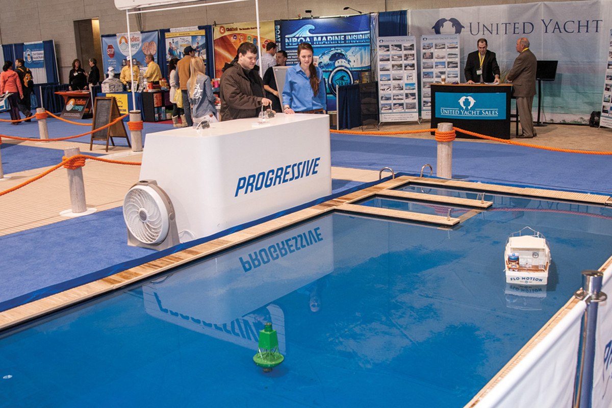 Exhibitors say business was good; Progressive Insurance calls its model boat Flo Motion — a nod to its popular spokeswoman.
