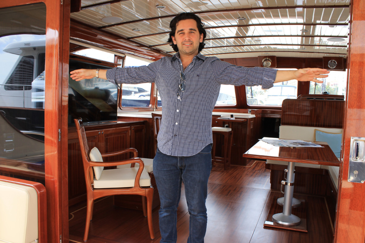 Vicem Yachts director of sales and marketing Turan Ozbakir shows off the large entrance that joins the cockpit with the galley, saloon and helm of a 65-footer in the builder's Classic line. This was the 16th year that Vicem has exhibited at the show.