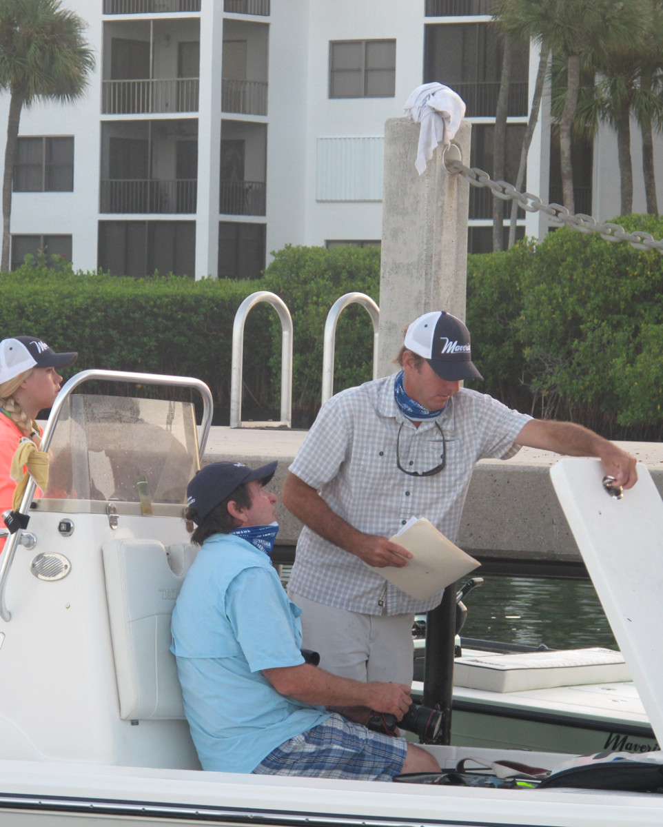 Charlie Johnson (right), director of product marketing and promotions at Maverick Boat Co., is shown with free-lance photographer Marc Vaughn on Tuesday during Maverick's media event in South Florida.