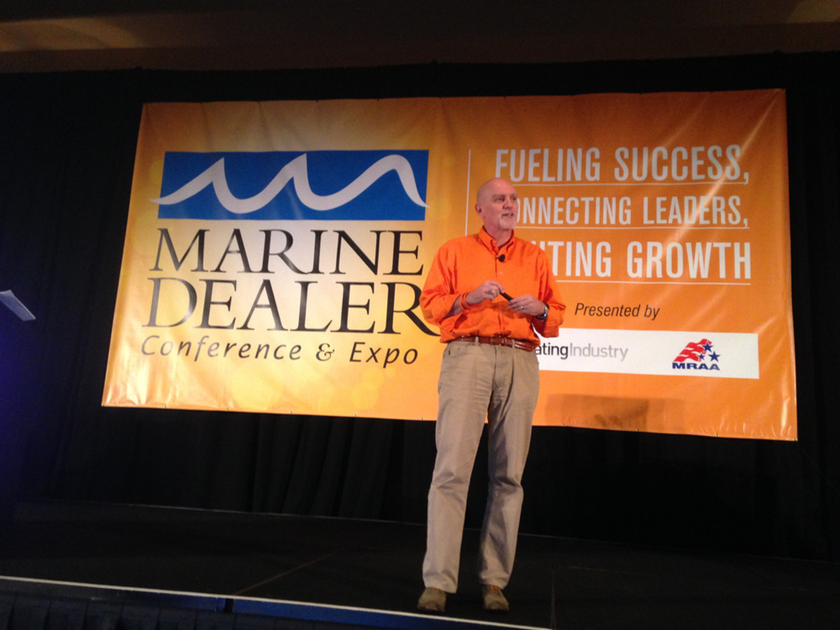 Author Chester Elton addresses conferees Monday night at the Marine Dealer Conference & Expo.