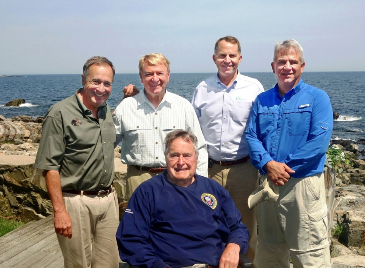 Conservation leaders gathered last Tuesday to go fishing with former President George H. W. Bush (front). They are (from left) Johnny Morris, founder and CEO of Bass Pro Shops; Matt Connolly, president of the Bonefish and Tarpon Trust; George Dunklin Jr., president of Ducks Unlimited; and Mike Nussman, president and CEO of the American Sportfishing Association.