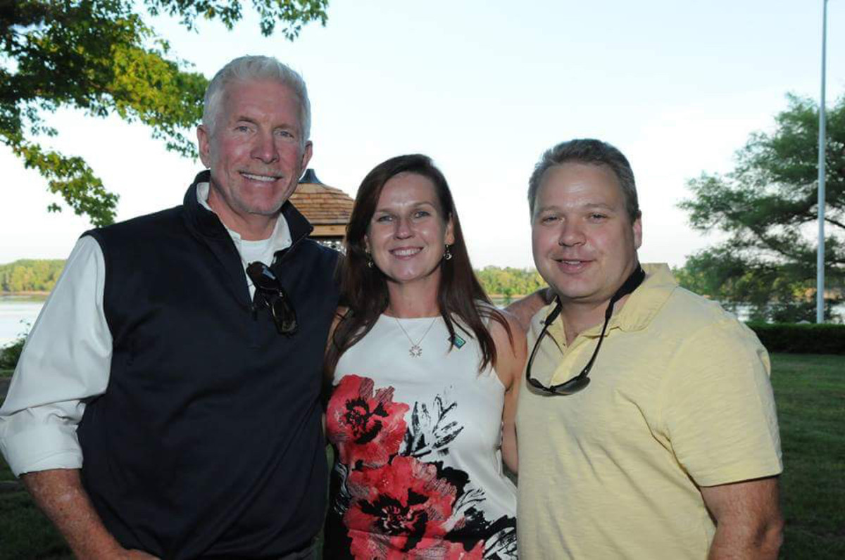 Former Philadelphia Phillies third baseman Mike Schmidt (left) is shown with SureShade co-founders Dana and Ron Russikoff.