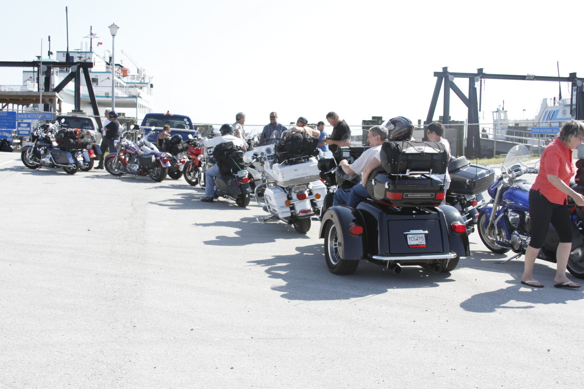 Tour riders wait to board the ferry at Cedar Island, N.C., on Tuesday for a ride to the Outer Banks.