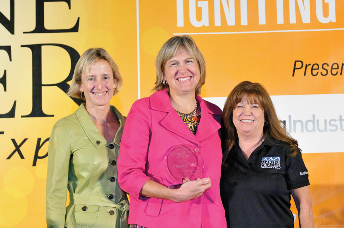BoatUS president Margaret Podlich (center) received the 2014 Darlene Briggs Woman of the Year Award. She is flanked by former winner Marcia Kull (left), who is vice president of sales at Volvo Penta and Boating Industry magazine national sales director Kathy Johnson.
