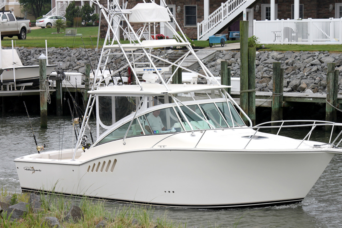 Canvas Experts of Ocean City, Md., fabricated a custom rigid enclosure with BreakWater X, EZ2CY marine tracks and a clear vinyl panel door for this Albemarle 330 Express.