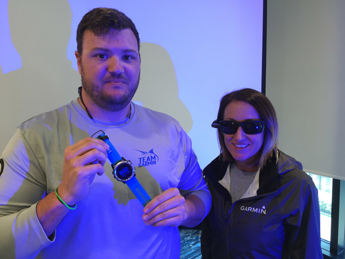 David Dunn, Garmin senior manager of marine sales and marketing, shows the Garmin quatix 3 marine GPS smartwatch. Media relations manager Carly Hysell is wearing sunglasses with Garmin's Nautix, an in-view display attachment that streams speed, depth, water temperature and other data.